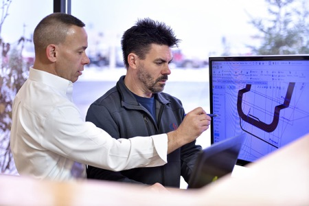 Mike Farber and Karl Schwenk looking at computer screen